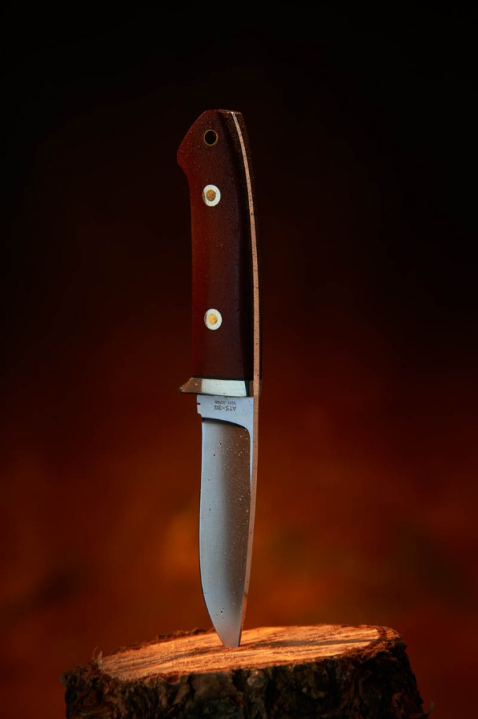 Product style shot of a hunting knife with a spritz of water