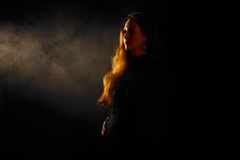 Dr-Dans-hi-light-discs-woman-model-in-a-black-body-suit-golden-hair-silhouette