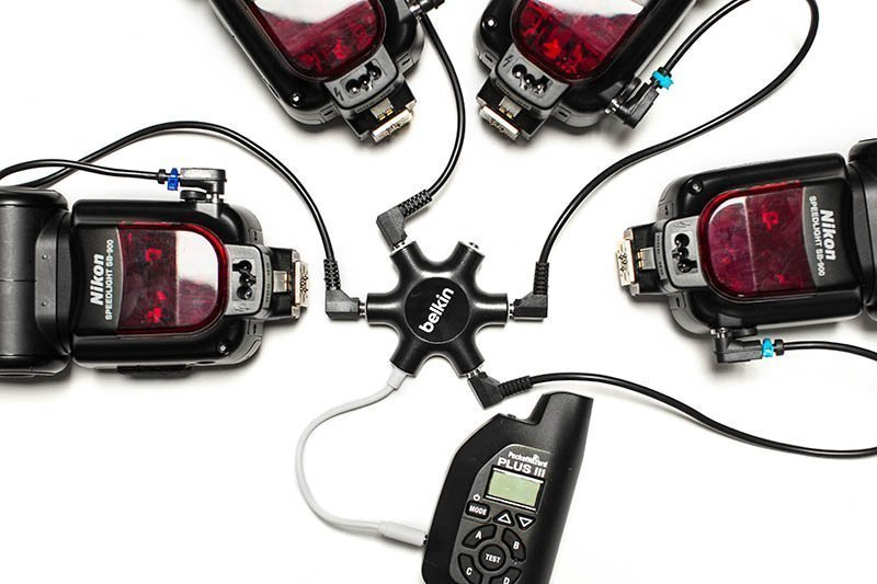 Image of a belkin rockstar and four nikon flash speed lights